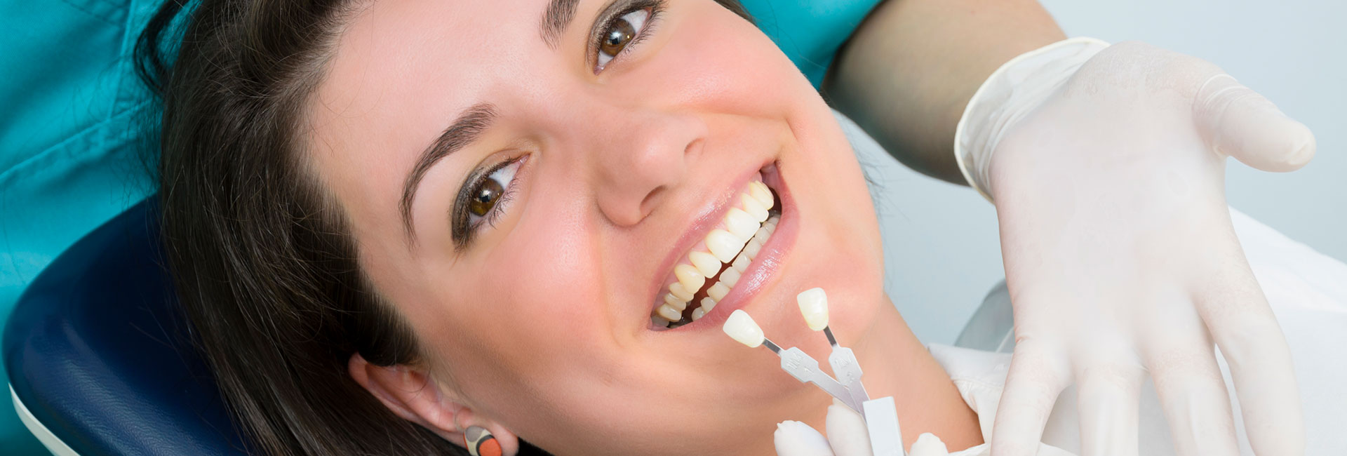 A Woman trying out dental implants