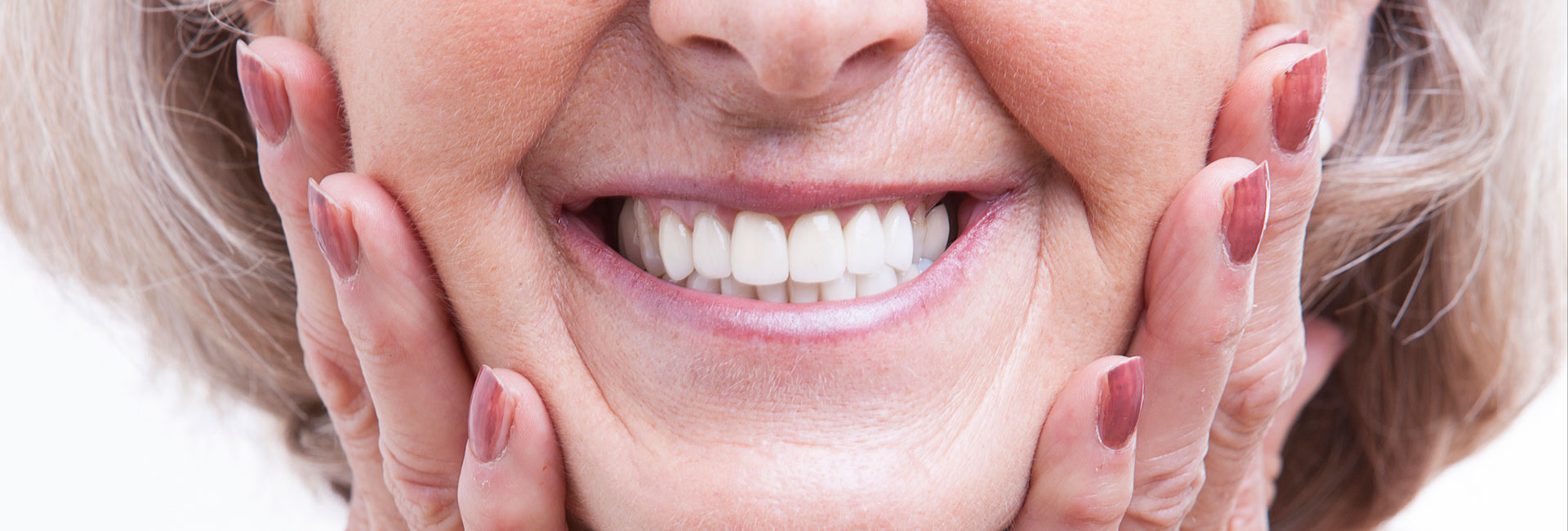 Happy elderly woman with dentures