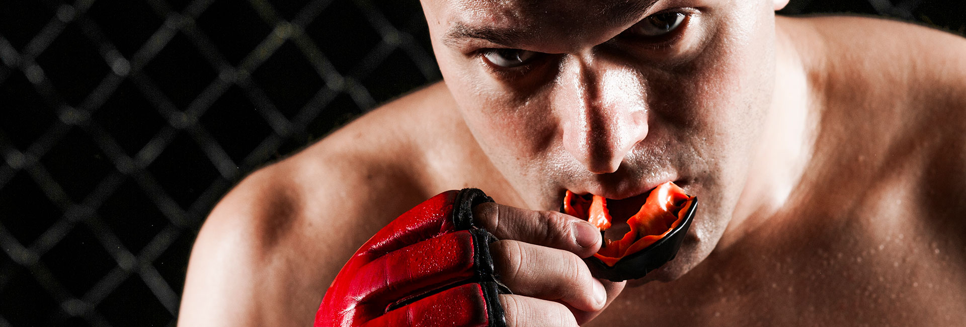 Mixed Martial Arts Fighter Using a Mouthguard