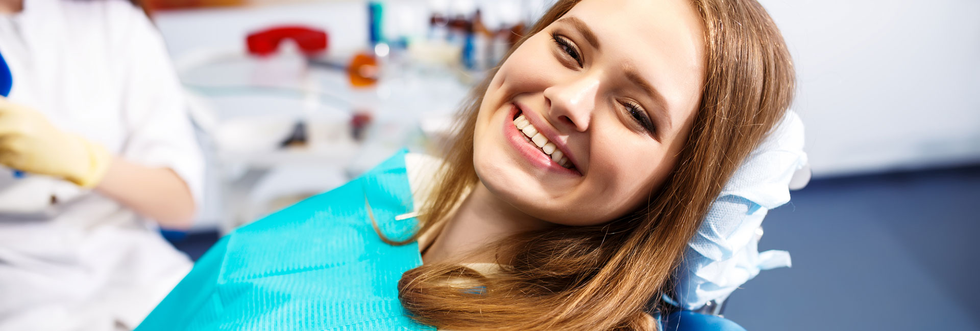 Smiling woman in a dental chair
